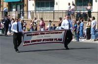 Carrying Banner in Parade